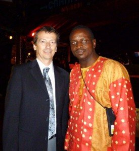 Two gentlemen wearing their traditional outfits at the Carnivore.